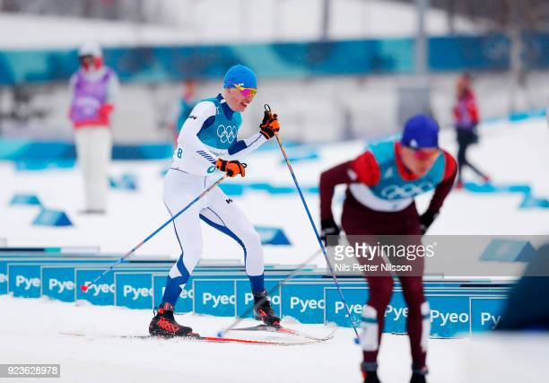 Iivo Niskanen of Finland changes his skis during the Mens 50k Classic competition at Alpensia Cross-Country Centre on February 24, 2018 in...