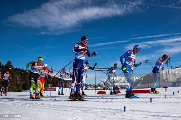Iivo Niskanen of Finland Francesco De Fabiani of Italy and Miha Simenc of Slovenia compete in the Cross Country Men's Team Sprint semifinal race...
