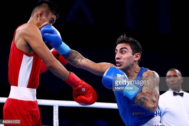 Ikbolijon Kholdarov of Uzbekistan and Artem Harytyunyan of Germany fight in the Men's light welter during the quarter finals of the AIBA World Boxing...