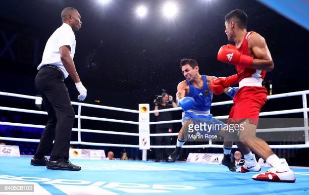 Ikbolijon Kholdarov of Uzbekistan knocks down Artem Harytyunyan of Germany in the Men's light welter during the quarter finals of the AIBA World...