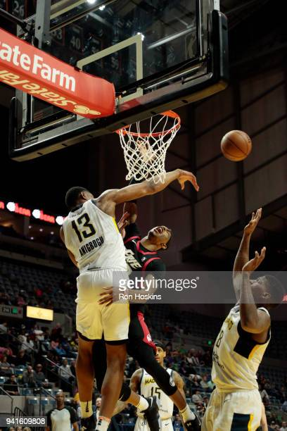 Ike Anigbogu of the Fort Wayne Mad Ants battles Craig Sword of the Erie Bayhawks in the 2018 Eastern Conference semifinals of the NBA G League on...