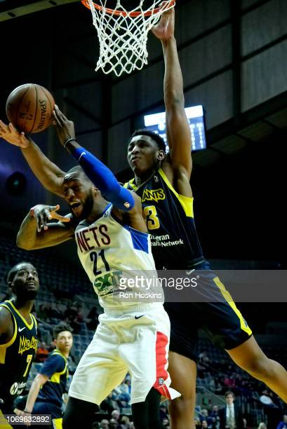 Ike Anigbogu of the Fort Wayne Mad Ants blocks the shot from Kamari Murphy of the Long Island Nets on December 7 2018 at Allen County War Memorial...