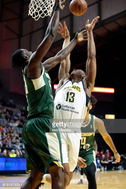 Ike Anigbogu of the Fort Wayne Mad Ants grabs the rebound against Wisconsin Herd defender on February 1 2018 at Memorial Coliseum in Fort Wayne...