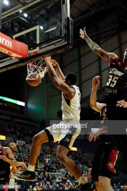 Ike Anigbogu of the Fort Wayne Mad Ants jams over Chris McCullough of the Erie Bayhawks in the 2018 Eastern Conference semifinals of the NBA G League...