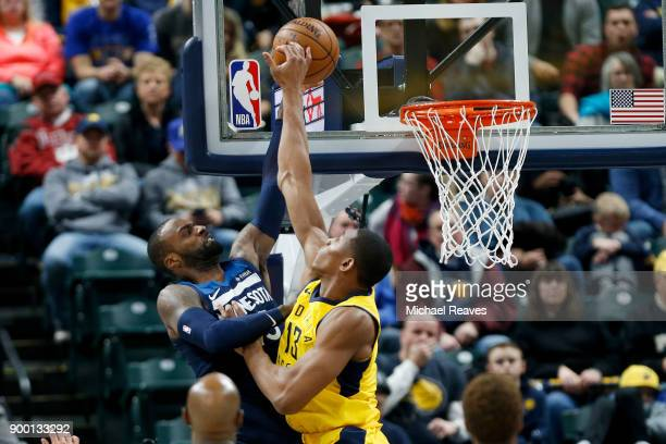 Ike Anigbogu of the Indiana Pacers blocks dunk by Shabazz Muhammad of the Minnesota Timberwolves during the second half at Bankers Life Fieldhouse on...