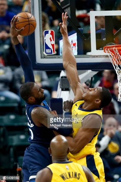 Ike Anigbogu of the Indiana Pacers defends a shot by Shabazz Muhammad of the Minnesota Timberwolves during the second half at Bankers Life Fieldhouse...