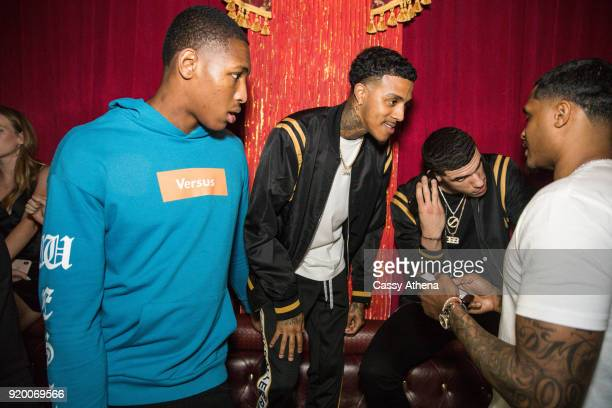 Ike Anigbogu of the Indiana Pacers guest Lonzo Ball of the Los Angeles Lakers and friend Darren Moore attend the Big Baller Brand hosts a fashion...