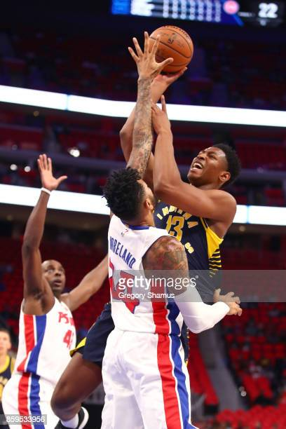 Ike Anigbogu of the Indiana Pacers tries to get a shot off over Eric Moreland of the Detroit Pistons during a pre season game at Little Caesars Arena...