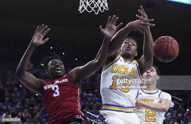 Ike Anigbogu of the UCLA Bruins and Robert Franks of the Washington State Cougars battle for a rebound in the first half of the game at Pauley...