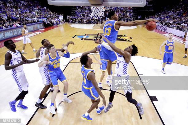 Ike Anigbogu of the UCLA Bruins blocks a shot against De'Aaron Fox of the Kentucky Wildcats in the first half during the 2017 NCAA Men's Basketball...