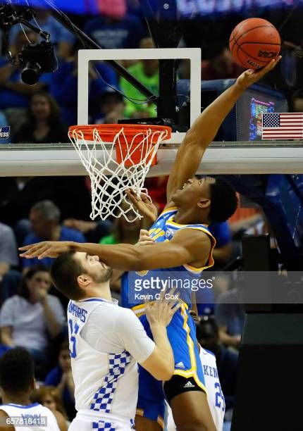 Ike Anigbogu of the UCLA Bruins goes up with the ball against Isaac Humphries of the Kentucky Wildcats in the first half during the 2017 NCAA Men's...