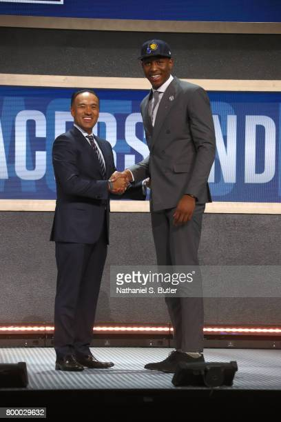 Ike Anigbogu shakes hands with Deputy Commissioner Mark Tatum after being selected number forty seventh overall by the Indiana Pacers during the 2017...