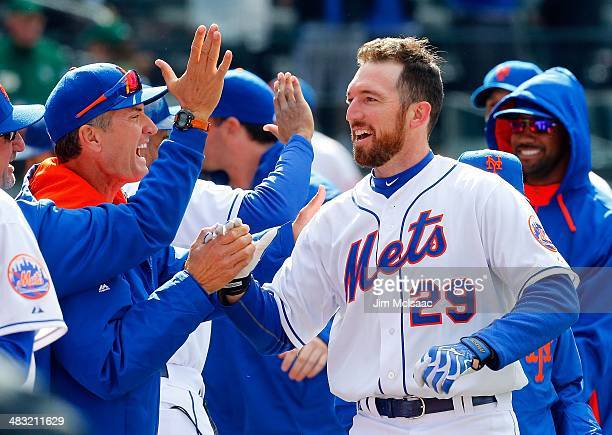 Ike Davis of the New York Mets celebrates his pinch hit ninth inning game winning grand slam against the Cincinnati Reds with his teammates at Citi...
