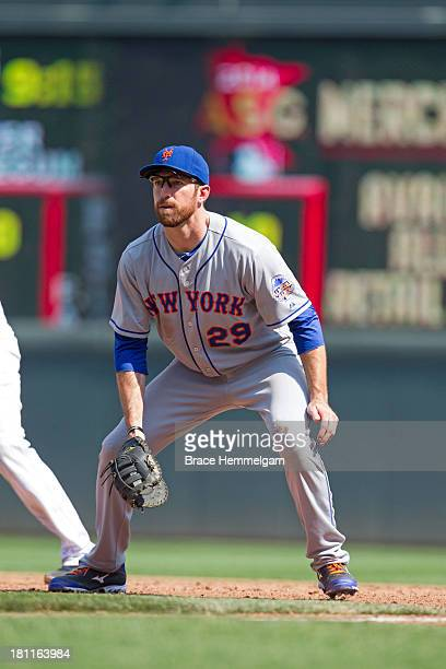 Ike Davis of the New York Mets fields against the Minnesota Twins on August 19 2013 at Target Field in Minneapolis Minnesota The Twins defeated the...