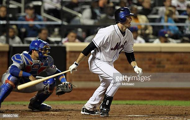 Ike Davis of the New York Mets hits a seventh inning RBI single against the Chicago Cubs on April 19, 2010 at Citi Field in the Flushing neighborhood...