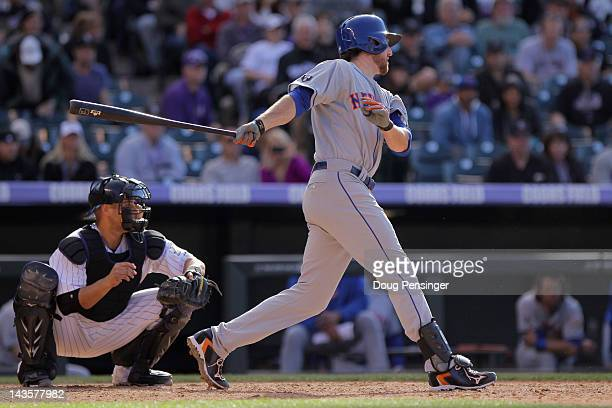 Ike Davis of the New York Mets hits the game winning RBI single off of Matt Belisle of the Colorado Rockies to score David Wright of the New York...