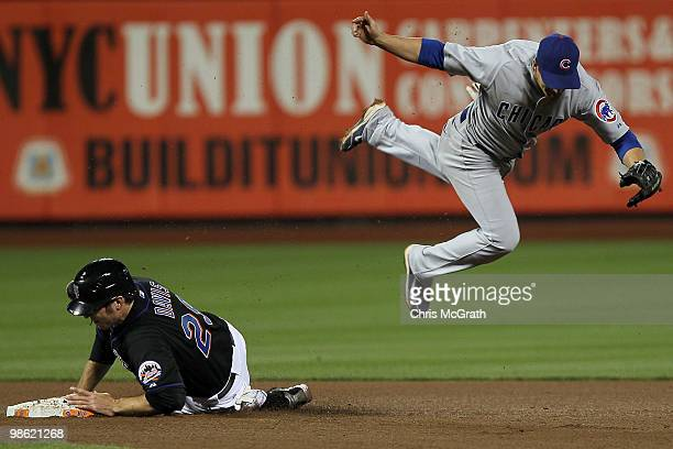 Ike Davis of the New York Mets slides into second base as Ryan Theriot of the Chicago Cubs dives over the top of him on April 22 2010 at Citi Field...