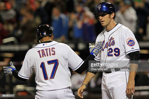 Ike Davis of the New York Mets waits to congratulate Fernando Tatis after he hit a two run homer against the Chicago Cubs on April 20 2010 at Citi...