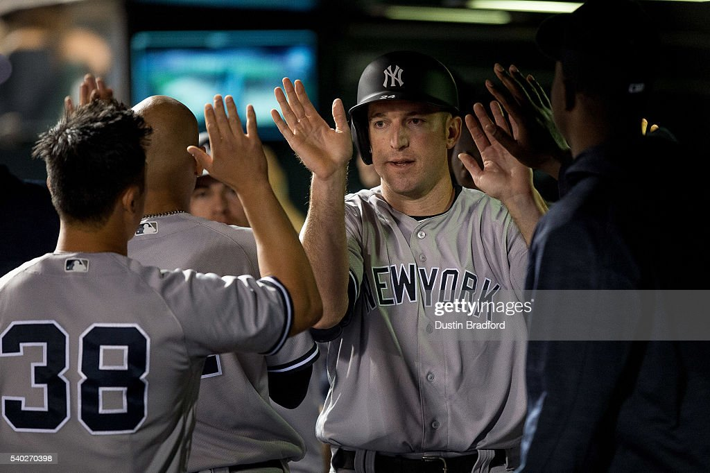 Ike Davis #24 of the New York Yankees celebrates an eighth inning run against the Colorado Rockies during a regular season interleague game at Coors Field on June 14, 2016 in Denver, Colorado.
