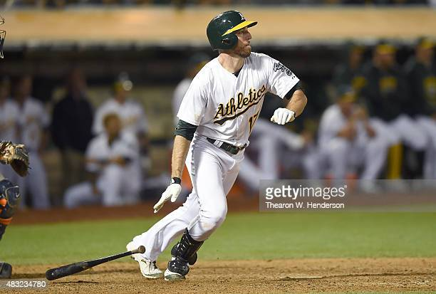 Ike Davis of the Oakland Athletics hits an rbi single scoring Stephen Vogt in the bottom of the ninth inning at Oco Coliseum on August 6 2015 in...