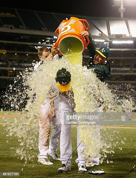 Ike Davis of the Oakland Athletics is showered with Gatorade by teammates after he hit a walkoff RBI single in the tenth inning against the Toronto...