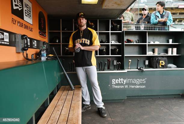 Ike Davis of the Pittburgh Pirates looks on from the dugout during batting practice prior to the game against the San Francisco Giants at ATT Park on...