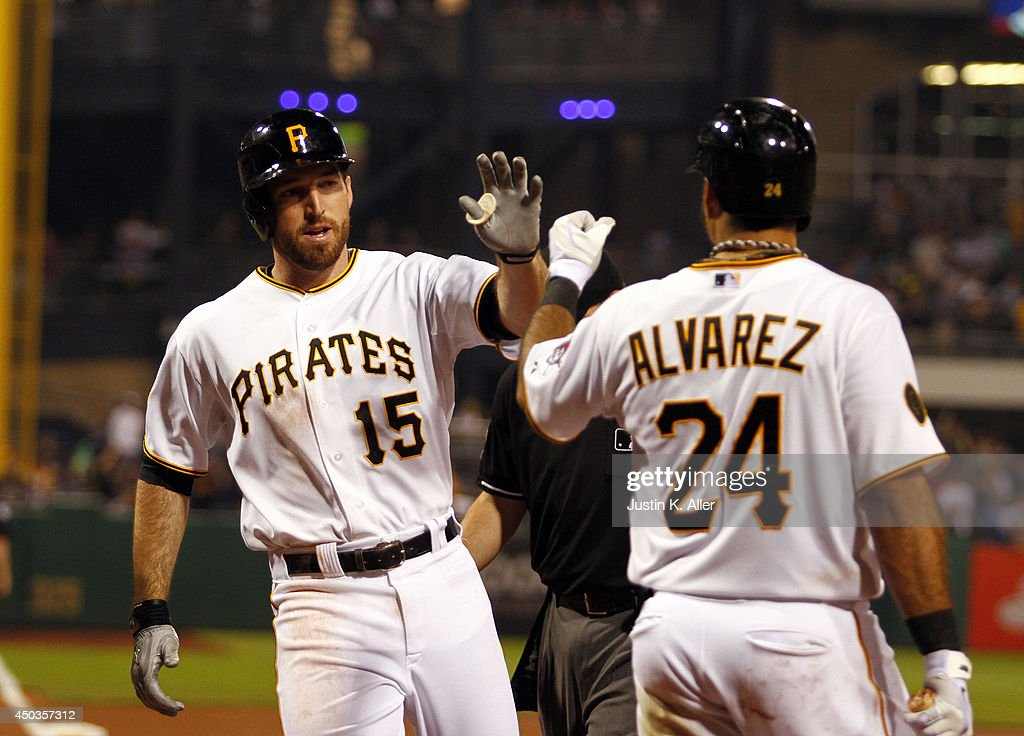Ike Davis #15 of the Pittsburgh Pirates celebrates with Pedro Alvarez #24 after hitting a home run in the ninth inning against the Chicago Cubs during the game at PNC Park on June 9, 2014 in Pittsburgh, Pennsylvania.