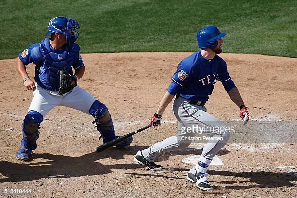 Ike Davis of the Texas Rangers hits a single against the Kansas City Royals during the sixth inning of the cactus leauge spring training game at...