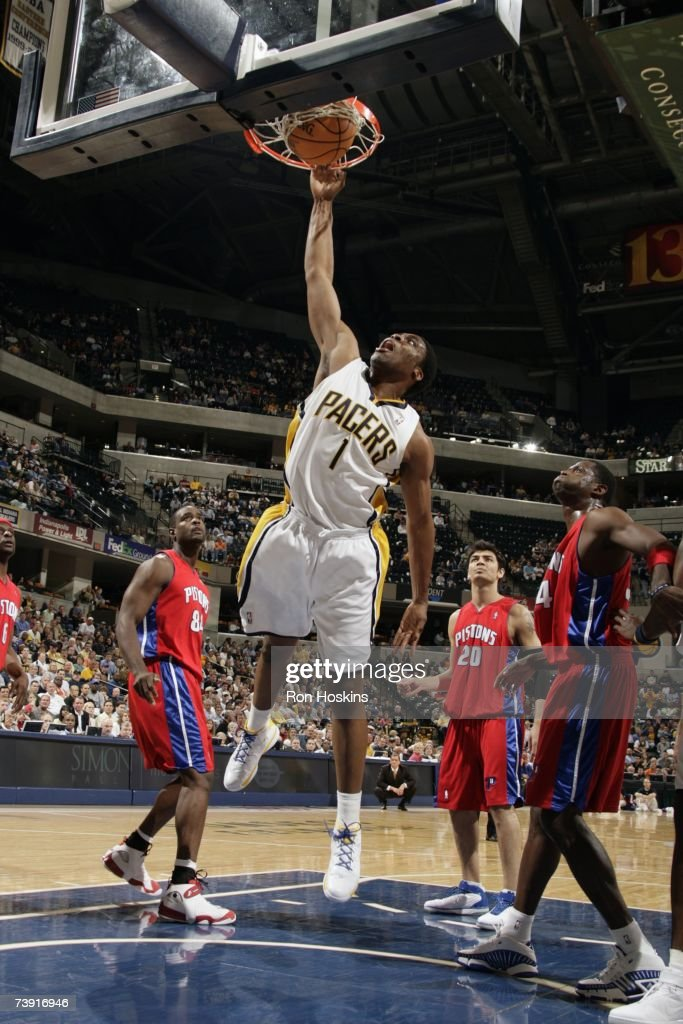 Ike Diogu #1 of the Indiana Pacers dunks over the Detroit Pistons defense during the game at Conseco Fieldhouse on April 3, 2007 in Indianapolis, Indiana. The Pistons won 100-85.