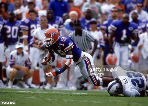 Ike Hilliard of the Florida Gators is tackled by Dele Ali of the Kentucky Wildcats on September 28 1996 at Ben Hill Griffin Stadium in Gainesville...