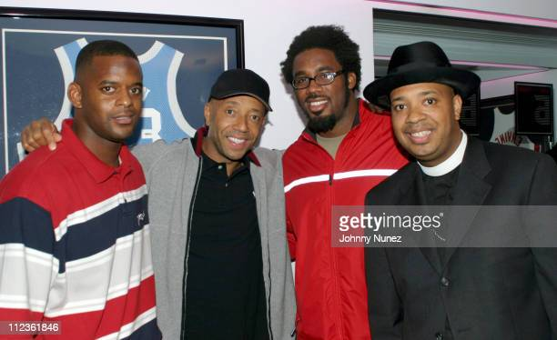 Ike Hilliard of the New York Giants Russell Simmons Dhani Jones of the New York Giants and Reverend Run