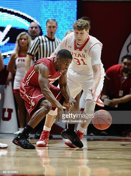 Ike Iroegbu of the Washington State Cougars and Dallin Bachynski of the Utah Utes try for the loose ball during first half action at the Jon M...