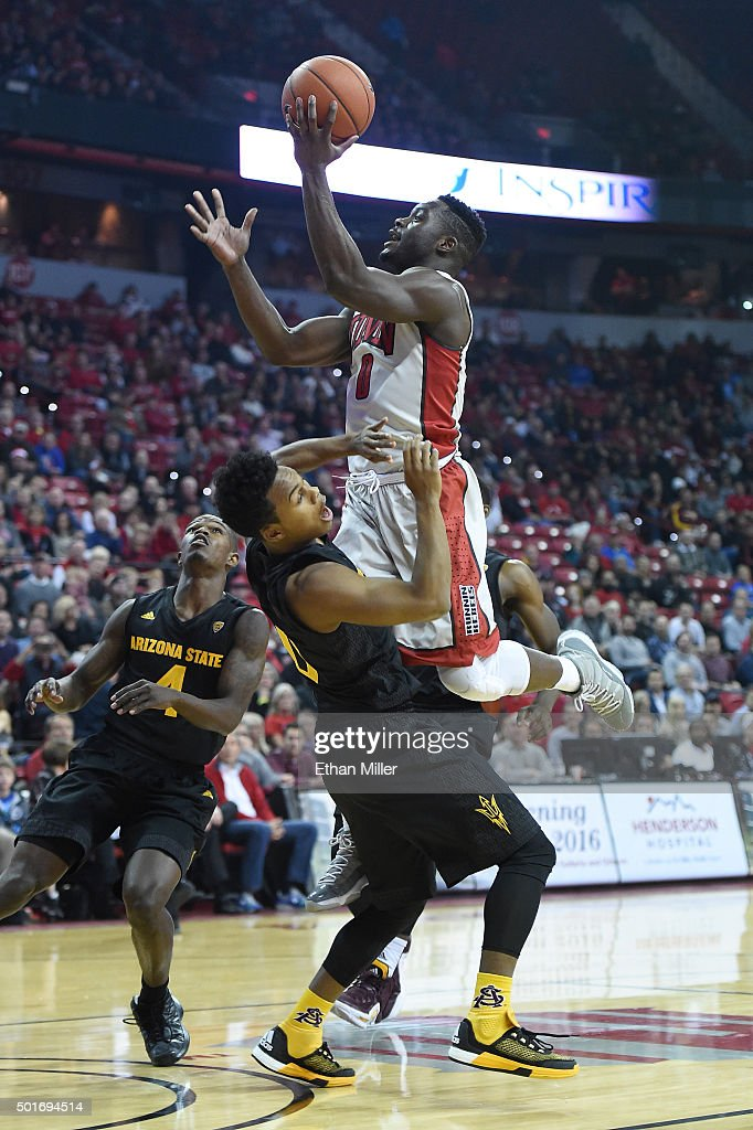 Ike Nwamu #0 of the UNLV Rebels is called for an offensive charge as he drives into Tra Holder #0 of the Arizona State Sun Devils during their game at the Thomas & Mack Center on December 16, 2015 in Las Vegas, Nevada.