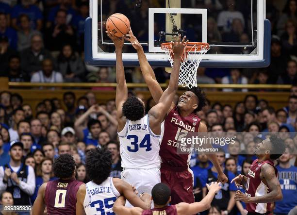 Ike Obiagu of the Florida State Seminoles blocks a shot by Wendell Carter Jr of the Duke Blue Devils during their game at Cameron Indoor Stadium on...