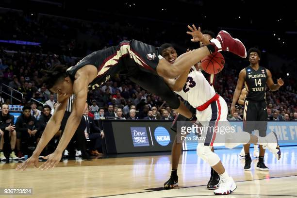 Ike Obiagu of the Florida State Seminoles tries to leap over Zach Norvell Jr #23 of the Gonzaga Bulldogs in the first half in the 2018 NCAA Men's...
