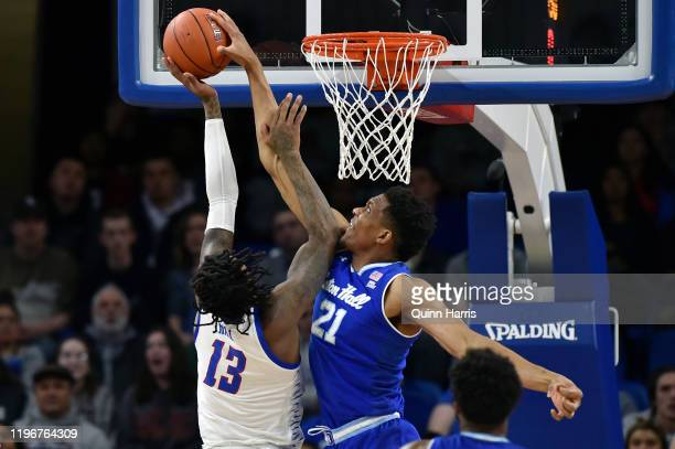Ike Obiagu of the Seton Hall Pirates blocks the shot attempt of Darious Hall of the DePaul Blue Demons in the first half at Wintrust Arena on...