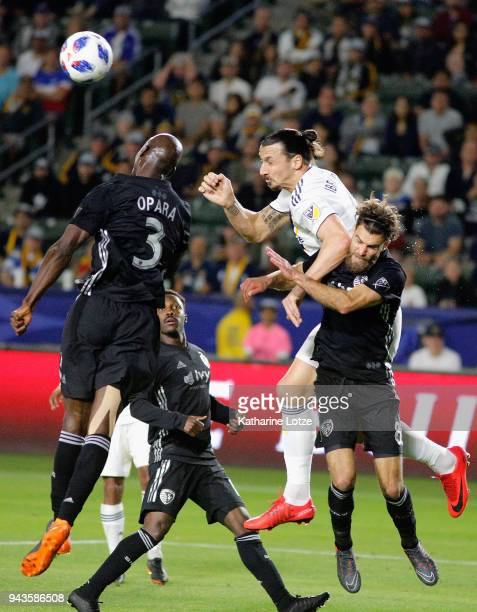 Ike Opara and Cristian Lobato of Sporting Kansas City defend against Zlatan Ibrahimovic of Los Angeles Galaxy during a game at StubHub Center on...