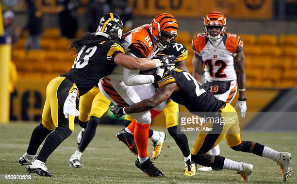 Ike Taylor and Troy Polamalu of the Pittsburgh Steelers tackle Jermaine Gresham of the Cincinnati Bengals during the game on December 15, 2013 at...