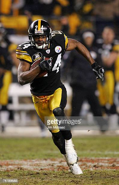 Ike Taylor of the Pittsburgh Steelers runs back an interception in the fourth quarter against the Jacksonville Jaguars during the AFC Wild Card game...