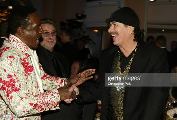 Ike Turner and Carlos Santana during Clive Davis Pre Grammy Party Backstage/Audience at Beverly Hills Hotel in Beverly Hills California United States