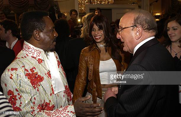 Ike Turner Clive Davis and guest during 2004 Clive Davis PreGrammy Party Inside Arrivals at Beverly Hills Hotel in Beverly Hills California United...