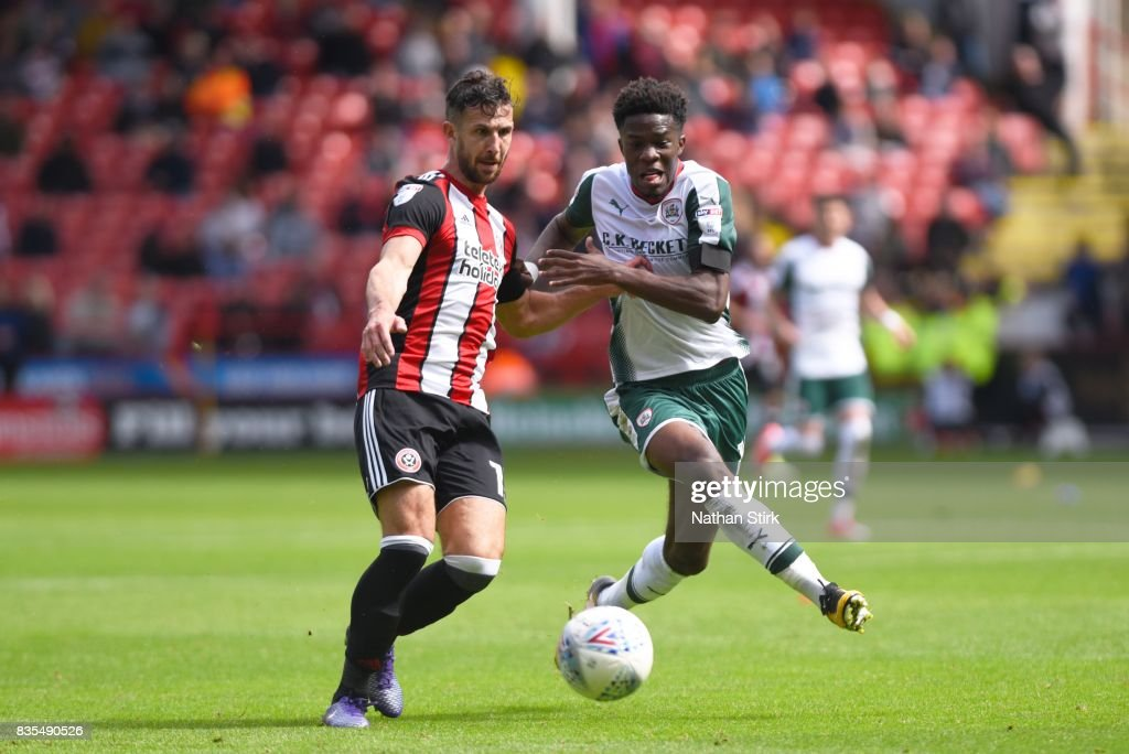 Ike Ugbo of Barnsley and Jake Wright of Sheffield United in action during the Sky Bet Championship match between Sheffield United and Barnsley at Bramall Lane on August 19, 2017 in Sheffield, England.