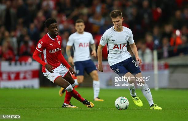 Ike Ugbo of Barnsley and Juan Foyth of Tottenham Hotspur during the Carabao Cup Third Round match between Tottenham Hotspur and Barnsley at Wembley...