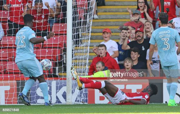 Ike Ugbo of Barnsley scores the opening goal during the Sky Bet Championship match between Barnsley and Sunderland at Oakwell Stadium on August 26...