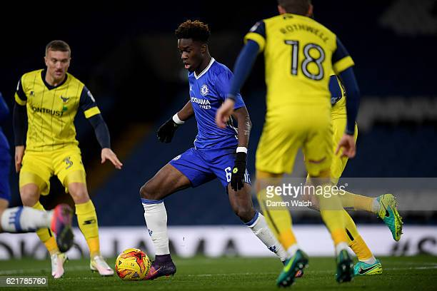 Ike Ugbo of Chelsea and Joe Skarz of Oxford United during a Checkatrade Trophy match between Chelsea and Oxford United at Stamford Bridge on November...