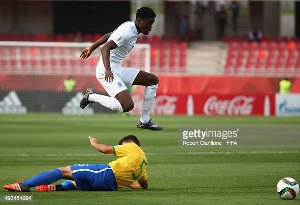Ike Ugbo of England leaps over Liziero of Brazil during the FIFA U17 World Cup Group B match between England and Brazil at Estadio La Portada on...