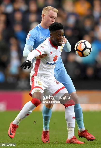 Ike Ugbo of Milton Keynes Dons and Jack Grimmer of Coventry City battle for the ball during The Emirates FA Cup Fourth Round match between Milton...