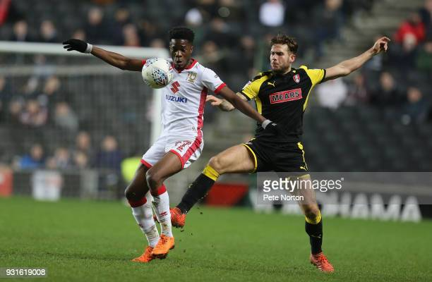 Ike Ugbo of Milton Keynes Dons contests the ball with Joe Mattock of Rotherham United during the Sky Bet League One match between Milton Keynes Dons...