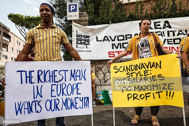 Ikea employees bring placards as they protest in front of the Swedish embassy against salary cut in Rome