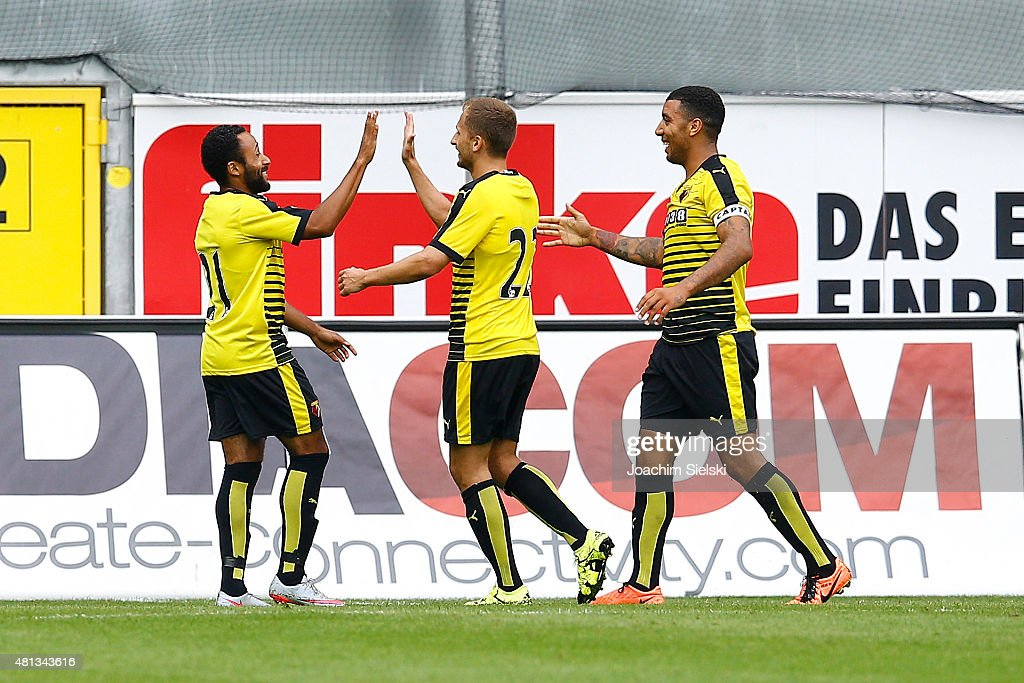Ikechi Anya, Almen Abdi and Troy Deeney of Watford celebration their second goal during the pre-season friendly match between SC Paderborn and Watford FC at Benteler Arena on July 19, 2015 in Paderborn, Germany.
